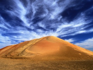 Cirrus Clouds Over a Man-Made Sand Dune