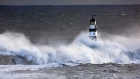 Seaham, Teesside, England; Waves crashing on lighthouse