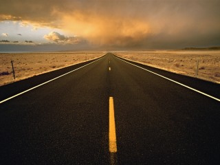 Desert Highway Leading to Storm