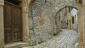 Cobblestone street and arch, Bale, Croatia