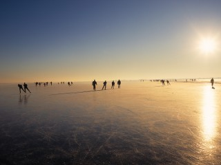Skaters on a Frozen Lake