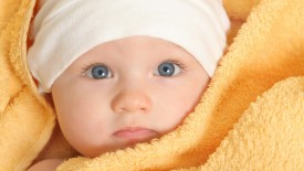 Baby Wrapped In Yellow Towel