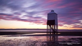 England, Somerset, Burnham-on-Sea. The low wooden pile lighthouse (Lighthouse on legs) at sunset.